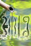 2019 zen bamboo fountain close up greeting card. 2019, zen bamboo fountain close up greeting card stock images