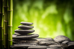 Zen basalt stones and bamboo. Still life with zen basalt stones and bamboo royalty free stock photo