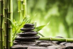 Zen basalt stones and bamboo Stock Photo