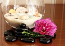 Zen basalt stones  and orchid... Stock Images