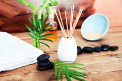 Zen basalt stones and spa oil on the wooden table Royalty Free Stock Image