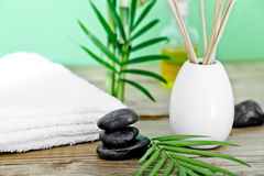 Zen basalt stones and spa oil on the wooden table Royalty Free Stock Photography
