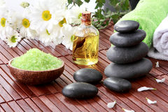 Zen basalt stones and spa products Royalty Free Stock Photo