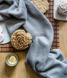 Zen bath with candle, fresh towel and natural sponge stock images