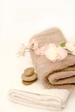 Zen Bathroom. Orchid blossom on towel with zen concept pebbles Royalty Free Stock Photos