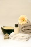 Zen Bathroom Spa. Calming and detoxing spa and bathroom session with calming candle, lotion and gerbera flower Stock Photo