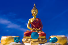Zen birma altar scene 01. Colorful meditation altar. Bright strong colors, red,blue and Gold Royalty Free Stock Images