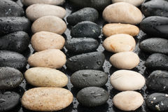 Zen black and white stones with water drops Royalty Free Stock Images