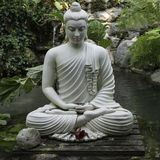Zen. Buddah Statue in a Zen Garden Royalty Free Stock Images