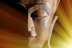 Zen Buddhism. Divine light rays of spiritual enlightenment or as. Tral projection on buddha head statue Stock Images