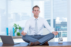 Zen businessman doing yoga meditation Royalty Free Stock Photos