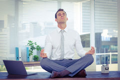 Zen businessman doing yoga meditation Royalty Free Stock Image