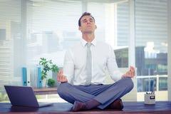 Zen businessman doing yoga meditation Royalty Free Stock Image