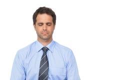 Zen businessman meditating with eyes closed. On white background stock photo