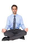 Zen businessman meditating in yoga pose Royalty Free Stock Photo