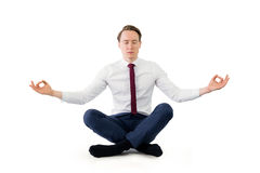 Zen businessman meditating in yoga pose Royalty Free Stock Images