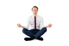 Zen businessman meditating in yoga pose Royalty Free Stock Photography