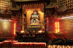 Zen candle and buddha statue Stock Image