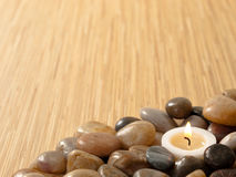 Zen candle in pebbles Royalty Free Stock Images