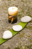 Zen candle and stones Stock Photo