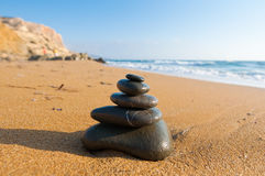 Zen composition on the beach. Royalty Free Stock Photo