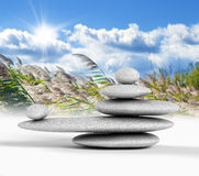 Zen concept. With balanced rocks,sky and nature background Royalty Free Stock Image