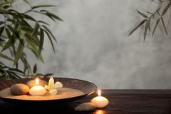 Zen concept. Burning candles with zen stone in bowl,zen concept Royalty Free Stock Image