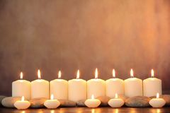 Zen concept. Zen stones and aromatic candles on table,Zen concept Royalty Free Stock Photos