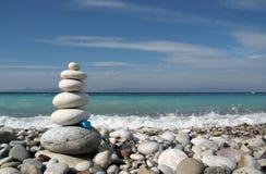Zen die op een kust voelt. Stock Fotografie