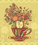 Zen-doodle cup of tea with flowers red  yellow green on beige background Stock Photos