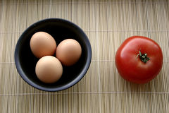 Zen Food for the Soul. Eggs and Tomato in black bowls Stock Photos