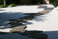 Zen Garden. Karesansui Gardens or dry landscape gardens were influenced mainly by Zen Buddhism and can be found at Zen temples of meditation (Japan Guide) Royalty Free Stock Photo