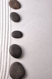 Zen garden. Stacked zen stones on zen garden Royalty Free Stock Photography