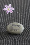 Zen garden. With energy stone in black sand Stock Photography