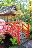 Zen Garden. Red Bridge in front a little Japanese house in the park of clingendael stock photography