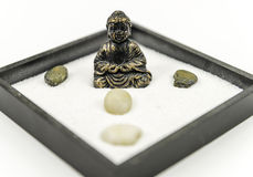 Zen garden with Buddha. Zen garden with rocks, rake and a Buddha Stock Image