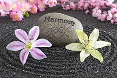 Zen garden of harmony. Zen garden in black sand with stone of harmony Royalty Free Stock Photos
