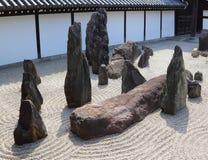 Zen garden in Kyoto. Famous zen garden with big stones on raked gravel in Tofuku-ji temple, Kyoto, Japan Royalty Free Stock Image