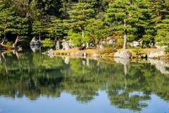 Zen garden with the lake in Kyoto, Japan Stock Photos