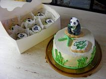 Zen garden, panda bear fondant cake. Funny bamboo, cake creem cheese with cupcakes in the box royalty free stock photos