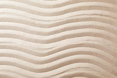 Zen garden pattern on sand as background, top view. Meditation and harmony royalty free stock photo