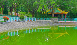 Zen garden with pavilion and green pond Royalty Free Stock Images
