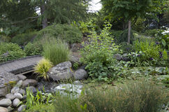 Zen garden pond bridge Stock Photos