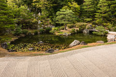 Zen garden with pond and pruned trees Stock Image