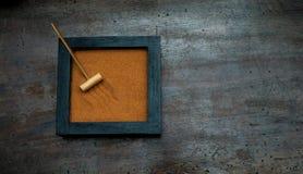Zen garden with rake on orange sand Stock Photo