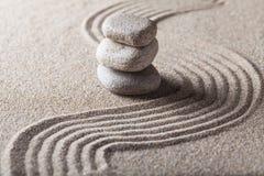 Zen Garden with Raked Sand and Balancing Pebbles. Stones rocks sand balance garden zen garden japanese royalty free stock photos