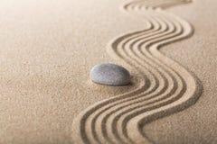 Zen garden with raked sand and a smooth stone. Abstract balance buddhism garden art concentration calm stock photos