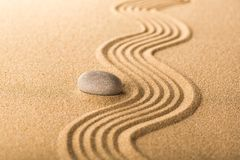 Zen garden with raked sand and a smooth stone. Abstract balance buddhism garden art concentration calm royalty free stock photography