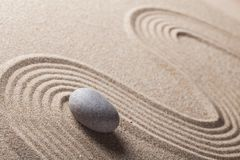 Zen Garden with Raked Sand and a Smooth Stone. Stone sand rock garden traditional zen pebble stock photo