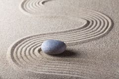 Zen Garden with Raked Sand and a Smooth Stone. Stone sand rock garden traditional zen pebble stock images